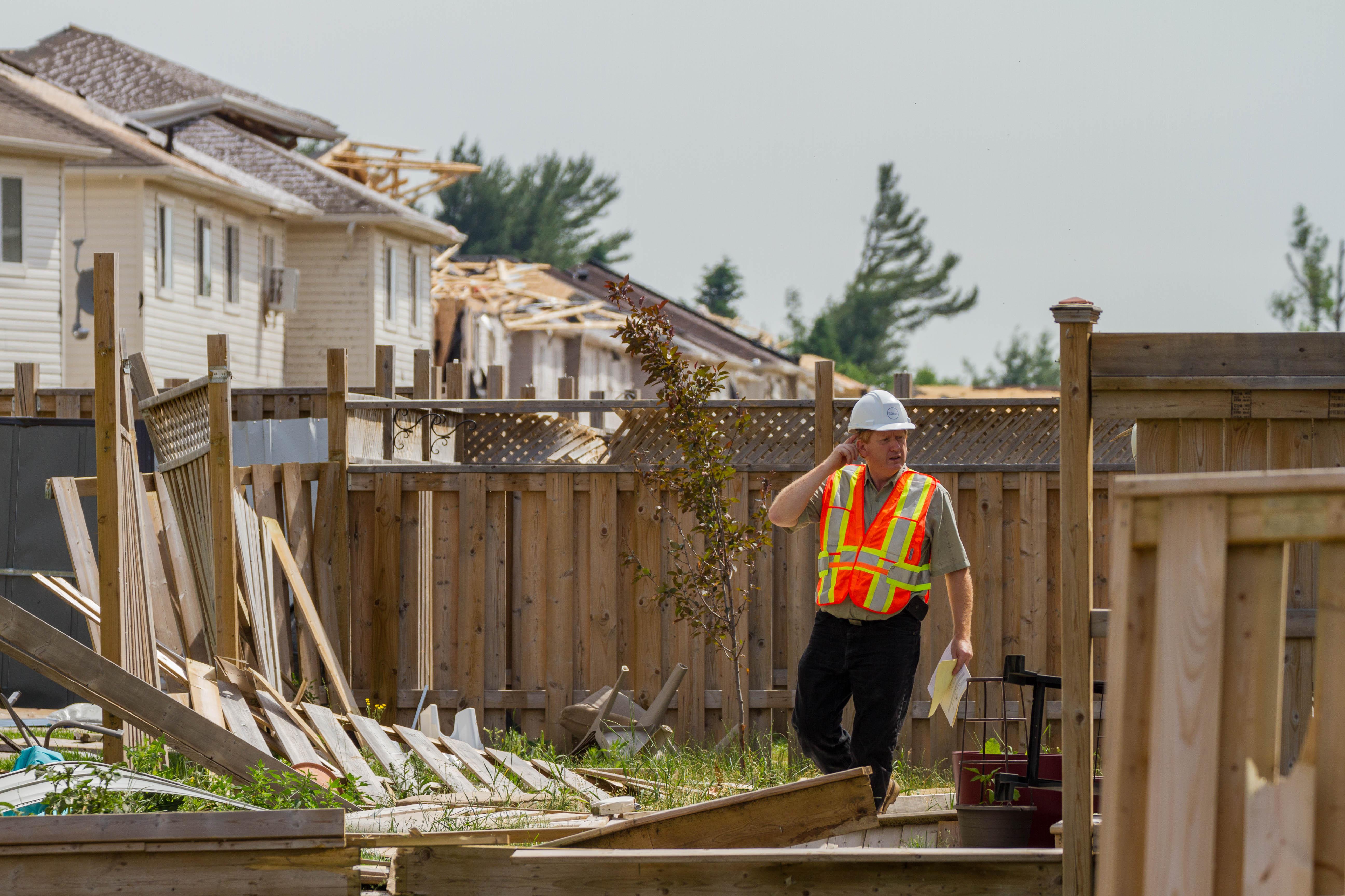 Insurance Adjuster Tallies Damage